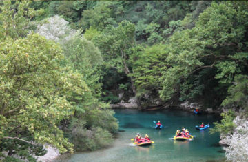 Rafting in the calm waters of Voidomatis river in the National Park of Vikos-Aoos, Epirus, Greece